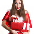 Emotional girl with presents — Stock Photo
