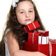 Sadnessed girl with presents — Stock Photo #36575765