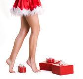 Beautifu llegs of christmas girl — Stock Photo