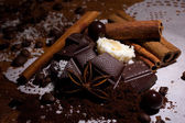 Heap of bonbons, chocolate and spices — Stock Photo