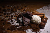 Heap of sweets, chocolate, coffee and spices — Stock Photo