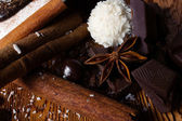 Heap of sweets, chocolate and spices — Stock Photo