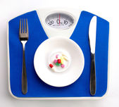Diet still with scale — Stock Photo