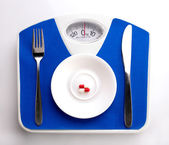 Plate on scale for dieting concept — Stock Photo