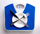 Empty plate for dieting concept — Stock Photo