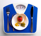 Centimeter and scale for dieting concept — Stock Photo