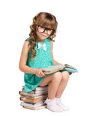 Girl siting on pile books — Stock Photo