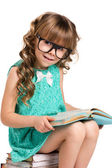 Little girl and old books — Stock Photo