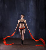 Athlete woman with red ribbons — Stock Photo