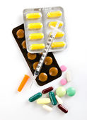 Medicaments  and insulin syringe — Stock Photo