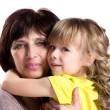 Embracing grandmother and granddaughter — Stock Photo #45585225