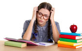 Teen girl doing homework — Stockfoto