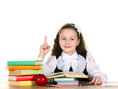 Schoolgirl with school accessories — Stock Photo