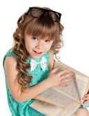 Preschooler girl with book — 图库照片