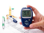 Glucometer in woman's hand — Stock Photo