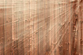 Dark wooden gnarly background in sunbeams — Stock Photo