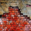 Stock Photo: Old damaged brick wall