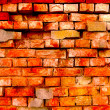 The old damaged brick wall — Stock Photo
