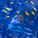 Transparent flag of European Union against the sky — Stock Photo #14346251
