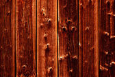 Wooden gnarly dark background — Stock Photo