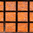 Stock Photo: Brick wall of half timbered house