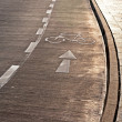 Bicycle path and sidewalk in the sunlight — Stock Photo