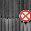 No stopping sign on asbestos wall — Stock Photo