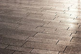 A street pavement and reflected sunlight — Stock Photo