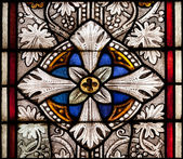 Fragment of colored ornamental glass of window of the church — Stock Photo