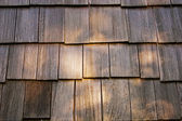 Wooden tile on the roof of the house — Stock Photo