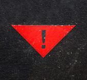 Warning sign on black background — Stock Photo
