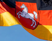 German flag of Lower Saxony against blue sky — Stock Photo