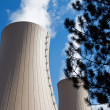 Tree branches against nuclear power plant — Stock Photo