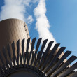 Stock Photo: Steam turbine against nuclear power plant and sky