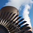 Stock Photo: Steam turbine against nuclear plant