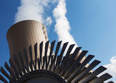 Steam turbine against nuclear power plant and sky — Stock Photo