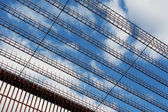 Fragment of security fence against blue sky — Stock Photo