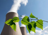 Green branch against nuclear power plant — Stock Photo
