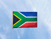 South African flag in the wind against the sky — Stok fotoğraf