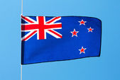 New Zealand flag in the wind against a sky — Zdjęcie stockowe