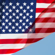 The American flag in wind against a sky — Stock Photo