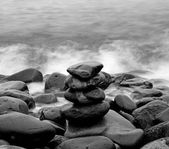 Pile of round smooth stones on seashore — Stock Photo