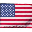American flag in the wind on a white background — Stock Photo