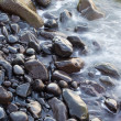 Coastal wet rocks and surf — Stock Photo