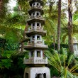Japanese pagoda in tropical garden — Stock Photo