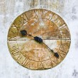 Stock Photo: Stone clock on a wall