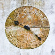Stone clock on a wall — Stock Photo