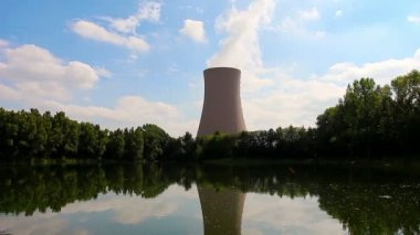Summer pond against nuclear power plant — Stock Video