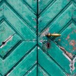 Stock Photo: Fragment of old and dilapidated doors