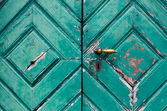 Fragment of old and dilapidated doors — Photo
